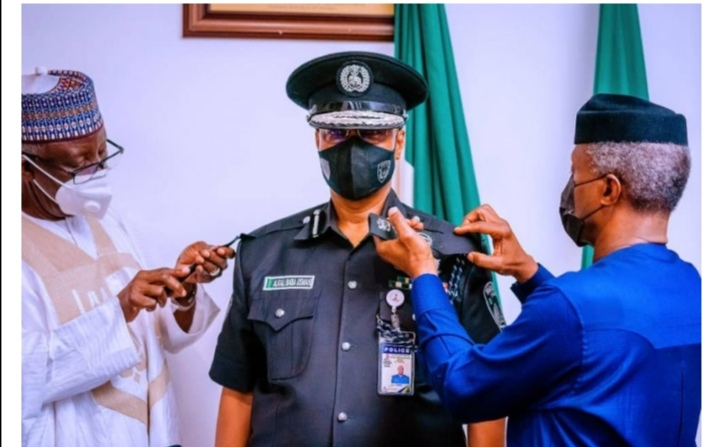 PHOTO NEWS: New IGP Decorated By Osinbajo, Resumes Duty In Loui's Edet House Abuja.